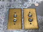 Vintage pair of brass push button switch plates