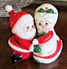 Hugging Santa and Mrs Claus Salt and Pepper Shakers EUC Lefton