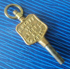 Advertising Pocket Watch Key  -  H. Wolfe of 182 York Street in Manchester