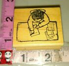 Person sitting at a desk writing remarkableC30rubber stamp wood