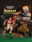 1997 STARTING LINEUP COLLEGE FOOTBALL STEVE OWENS FIGURE WITH HEISMAN TROPHY