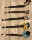TOP LOT 5 ANTIQUE WOODEN TURNED 1800S LACE BOBBINS WITH SPANGLES