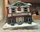Manufactures model Christmas Village Movie Theater showing A Christmas Carol