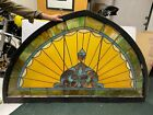antique stained glass window 72 wide 44tall