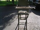 Antique Wooden High Chair with cane seat and carving on the back