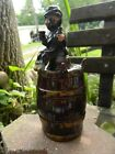 pottery Decanter. barrel & man in derby with glass and bottle.