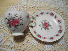 Vintage Queen Anne cup and saucer.  Made in England.  Rose design/gilt