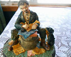 Figurine Ceramic Hobo Sitting & Writing With Dog Looking Up At Him on Wood