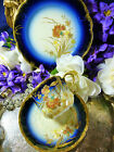 LIMOGES D & C MOULDED TEA CUP AND SAUCER TRIO COBALT H.P FLOWERS c1894 GILT