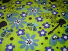 FLOWERS GUITARS ON GREEN ANTI PILL FLEECE FABRIC SOLD BY THE YARD