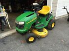 John Deere L110 with snowblower blades and double bagger