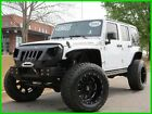 2015 Jeep Wrangler JEEP WRANGLER UNLIMITED RUBICON CLEAN CARFAX JEEP WRANGLER UNLIMITED RUBICON LIFTED MANUAL 3.5 INCH LIFT FAB FOUR BUMPER