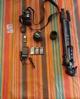 Nikon D3000 with 2 lenses 3 batteries tripod and camera bag More in desc