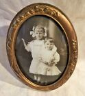ANTIQUE VICTORIAN BRASS OVAL EASEL FRAMEMWITH PHOTO OF CHILDREN