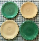 VINTAGE ORIGINAL IVORY AND LIGHT GREEN FIESTAWARE 9.5 INCH PLATES - LOT OF FOUR