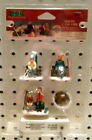 NEW- LEMAX VILLAGE COLLECTION - SKIERS CAMP FIRE -SET OF 4 -MADE IN 2000 - 04468