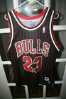 VINTAGE CHICAGO BULLS AUTHENTIC CHAMPION MICHAEL JORDAN PINSTRIPED BLACK JERSEY
