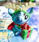 DISNEY PARKS BLOWN GLASS STITCH W PRESENT GLITTER ANTLERS CHRISTMAS ORNAMENT NWT
