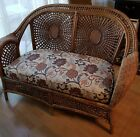 Vintage ornate wicker rattan settee or loveseat with floral cushion