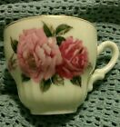 Miniature porcelain teacup gold trim pink roses made in (occupied?) Japan