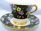 TUSCAN BLACK PASTEL ENAMEL FLOWER CHINTZ GOLD ART DECO TEA CUP AND SAUCER