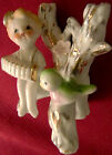 Porcelain Vintage 50's figurine girl w/ accordian sitting in tree Made in Japan