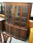 DREXEL MAHOGANY BREAKFRONT WITH A SERPENTINE FRONT AND CURVED GLASS ... Lot 1192