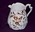 Antique Ceramic white cream pitcher with gold highlights and fancy handle