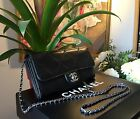 Beautiful black Chanel clutch with stowable chain
