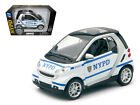 New Ray 71203 Smart For Two NYPD Police Car 1 24 Diecast Model Car