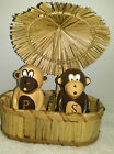 HOME CERAMIC MONKEY SALT AND PEPPER SHAKER IN STROW CABANA UNDER STROW UMBRELLA