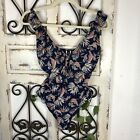Nip tuck ruffle detail one piece floral swimsuit Size 4