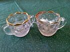 Vintage glass cream and sugar set with ribbed pattern, gold rim