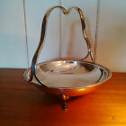 A silver plate cake / bread basket with fixed handle