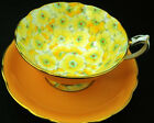 PARAGON FLOWER PETAL CHINTZ YELLOW VERY WIDE TEA CUP AND SAUCER