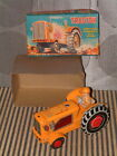 VINTAGE, NOMURA FRICTION POWERED W/SPARK TIN TRACTOR. PERFECTLY WORKING W/BOX!