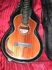 Mele GuitarleleVintage Primo Tiger Stripe Flamed Koa with Cutaway Xlnt Case