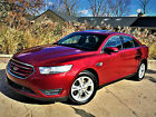 2014 Ford Taurus SEL Sedan below $13000 dollars