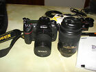 Nikon D300 with 25 80mm and 55 300mm lenses bag charger and other extras
