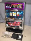 SLOT MACHINE OLYMPIA EVOLUTION MODEL RED METEOR uses US Quarters or Tokens
