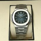 Patek Philippe Nautilus 5711/1A 001 with box and papers Pre-owned