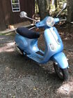 2007 Blue Vespa LX 150 with Car Carrier
