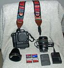 Canon EOS Rebel 20D with grip Sigma 18 200mm 72mm UV Haze filter 2 batteries