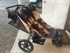Double Bob Stroller in good condition. Dark blue with cup and key holder