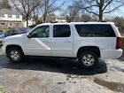 2007 Chevrolet Suburban salvage damaged below $5000 dollars