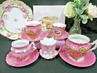 GERMANY tea cup and saucer lot pink molded footed teacup set lustreware German