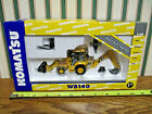 Komatsu WB140 Backhoe Loader With Work Tools By Norscot 1 50th Scale