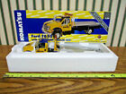 Komatsu Ford F650 With Equipment Hauler Bed By First Gear 1 34th Scale