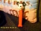 Red Mickey Mouse Pez with feet, back of head has c disney, --- BOX 4