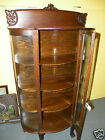 Antique oak curved front display China cabinet with Paw feet